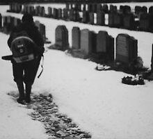MAN IN SNOWY CEMETERY  by alexandriaiona