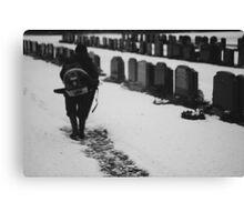 MAN IN SNOWY CEMETERY  Canvas Print