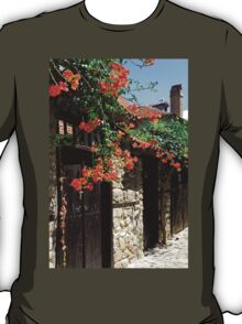 Flowers stretching out over the gates of an old house in Nessebar, Bulgaria T-Shirt