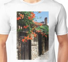 Flowers stretching out over the gates of an old house in Nessebar, Bulgaria Unisex T-Shirt