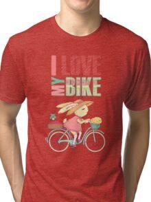 Cute rabbit riding a bike Tri-blend T-Shirt