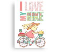 Cute rabbit riding a bike Canvas Print
