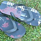 Thongs on grass by jaroas
