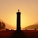 Glenfinnan Monument in the Winter Sunset. by John Cameron