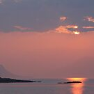 Sunset over Eigg and Rhum from Arisaig. by John Cameron