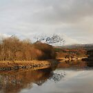 Snow covered Ben Nevis from the Caledonian Canal. by John Cameron