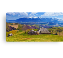 Wooden house and mountains panorama Canvas Print