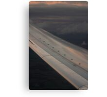 Airplane flying in sky wing in flight photograph Canvas Print