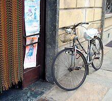 bike in doorway saluzzo italy by lisac