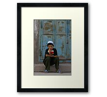 The youthful reader Framed Print