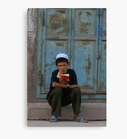 The youthful reader Canvas Print
