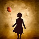 A girl and her balloon by Kurt  Tutschek