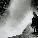 Man By Waterfall by Mike Paget