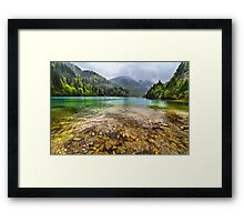 Lake in mountains, in a rainy day Framed Print