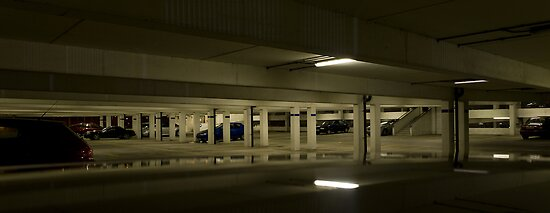 Underground Car Parking Facility at Night by Rob Davies