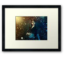 Girl in snowstorm Framed Print