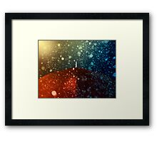 Red umbrella in snowstorm Framed Print