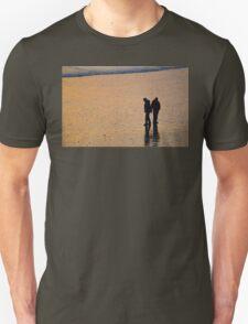 Couple on beach at sunset Unisex T-Shirt