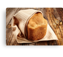 Homemade bread on a wooden board Canvas Print