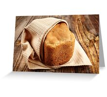 Homemade bread on a wooden board Greeting Card