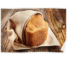 Homemade bread on a wooden board Poster