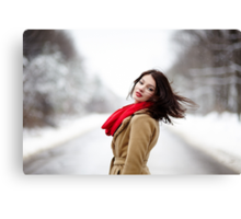 Beautiful brunette with hair blown by wind in the winter Canvas Print