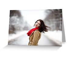 Beautiful brunette with hair blown by wind in the winter Greeting Card