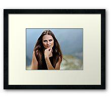 Beautiful woman in a mountain landscape Framed Print
