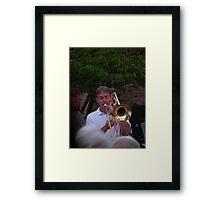 sly trombone player Framed Print