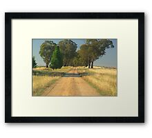 Track over a hill Framed Print