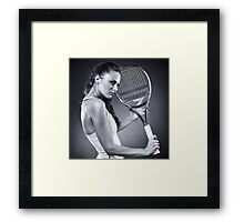 Young female tennis player with racket Framed Print