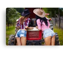Sexy female farmers fixing the tractor Canvas Print
