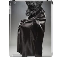 Witch wearing black attire with face hidden iPad Case/Skin