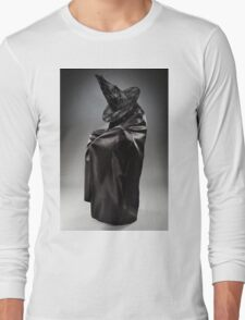 Witch wearing black attire with face hidden Long Sleeve T-Shirt