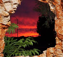 Sunrise thru the hole by robert murray
