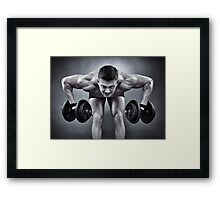 Athletic man working with heavy dumbbells Framed Print