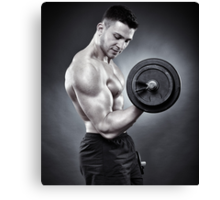 Athletic man working out with heavy dumbbells Canvas Print