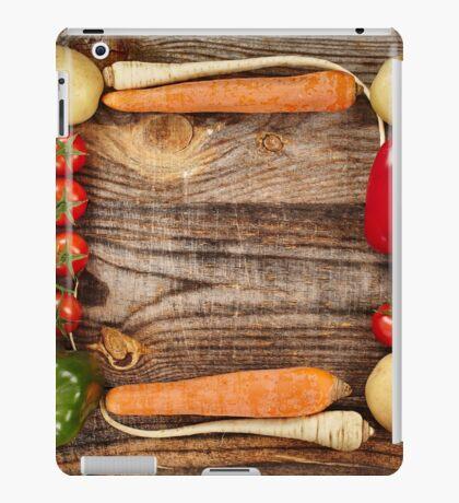 Vegetables frame on wooden board iPad Case/Skin