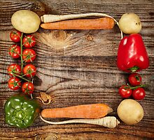 Vegetables frame on wooden board by naturalis