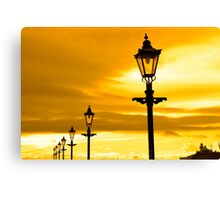 row of vintage lamps at sunset Canvas Print