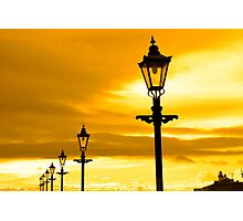 row of vintage lamps at sunset Photographic Print
