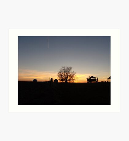 Sunset behind farm equipment in rural iowa Art Print