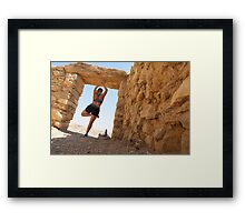 Woman worksout in ancient ruins in the desert  Framed Print