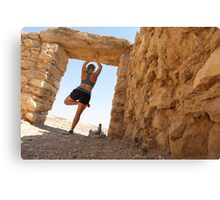 Woman worksout in ancient ruins in the desert  Canvas Print