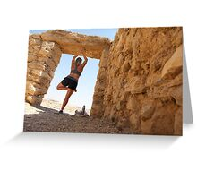 Woman worksout in ancient ruins in the desert  Greeting Card