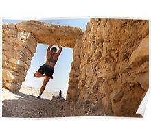 Woman worksout in ancient ruins in the desert  Poster