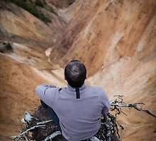 Sitting on the edge of a cliff by naturalis