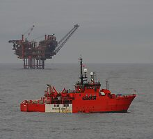 The Lomond Platform and the standby vessel Esvagt Supporter, central north sea. by Alex Young