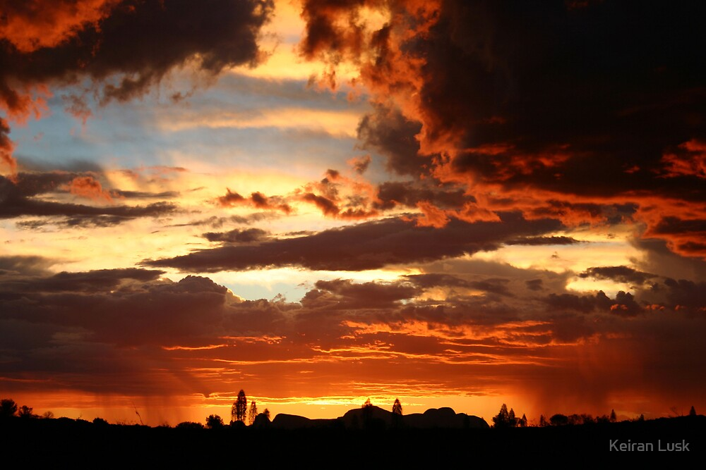 Stormy sunset skies over the desert by Keiran Lusk