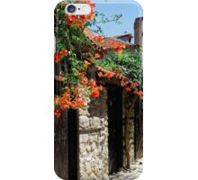 Flowers stretching out over the gates of an old house in Nessebar, Bulgaria iPhone Case/Skin
